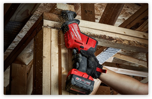 Person using Milwaukee tool
